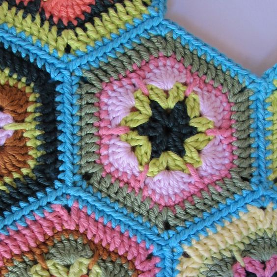 """Single crochet """"join as you go""""  instructions. This is a tutorial on joining crocheted motifs together with single crochet stitches."""