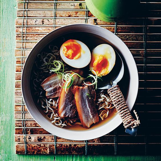 oon mirin 1 garlic clove, crushed 1 teaspoon freshly grated/shredded ginger 50 ml/¼ cup dark soy sauce 50 ml/¼ cup light soy sauce 1 tablespoon caster/granulated sugar 750 g/1½ lb. piece of pork belly, skin removed 4 eggs 2 litres/2 quarts chicken stock 250 g/9 oz. dried ramen noodles spring onions/scallions, thinly sliced to garnish Serves 4