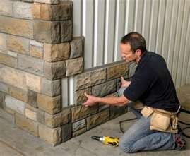 Faux stone. Easy to pop on the side of a house for an exterior change. perfect colors