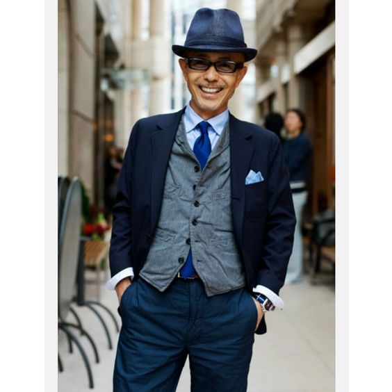 Blue suit and tie with grey waistcoat. An effortless look. http