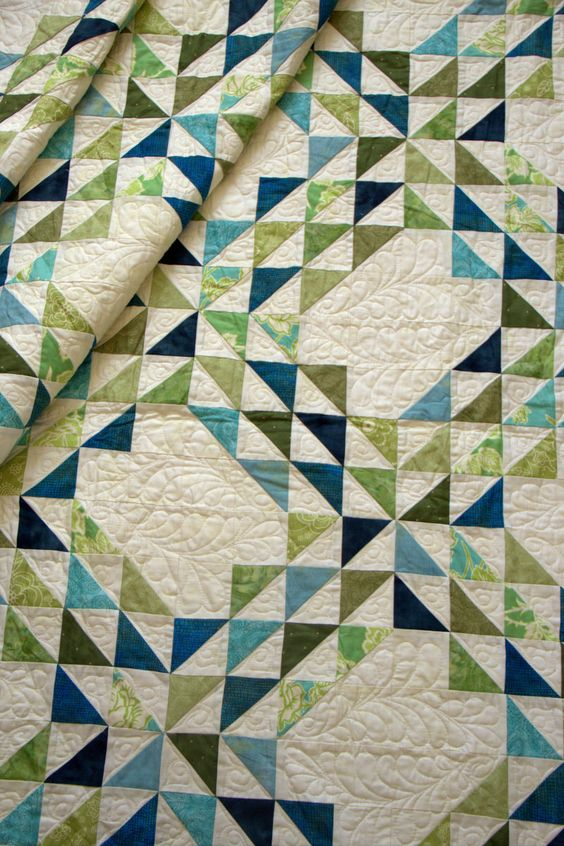 Ocean Waves | green and blue quilt. half square triangles. quilted feathers: