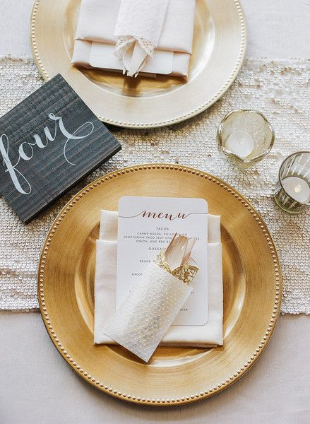 Gold  ivory wedding place setting idea - gold chargers white linens  menu cards with modern gold calligraphy Boudoir Moderne by Allie Lindsey Photography