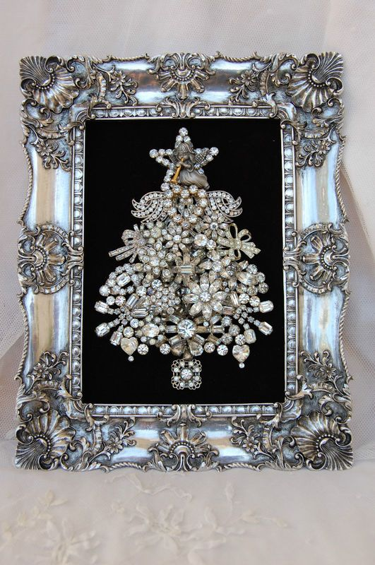 Framed Christmas tree of vintage brooches.