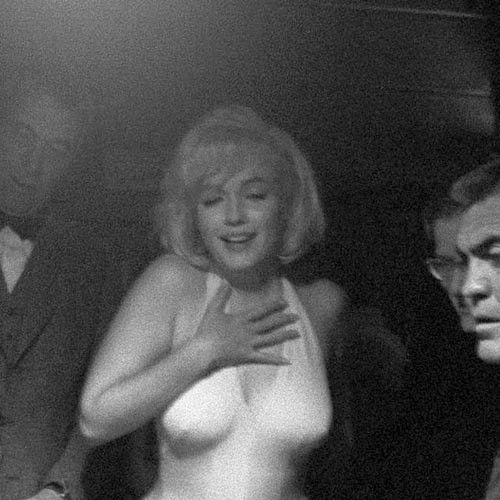 Marilyn Monroe and director John Huston at a Reno casino during the filming of The Misfits, 1960. Photo by Eve Arnold.