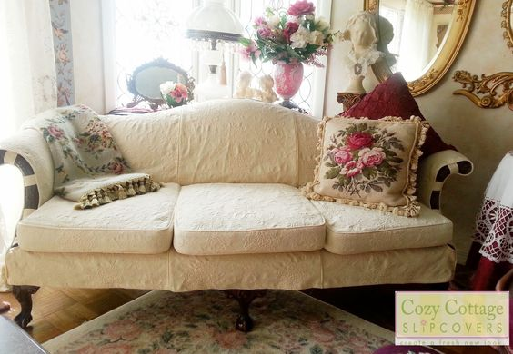Slipcover with Exposed Wood Details.  Great job cozycottageslipcovers.com