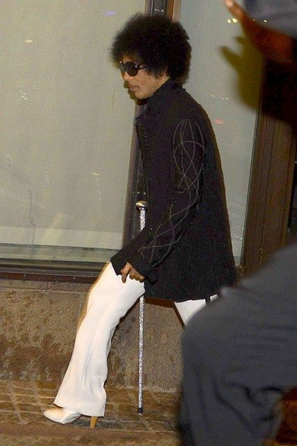 AUGUST 3 – Prince winds down at Café Opera in Stockholm following his Stockholm concert. The musician conspicuously arrived wearing high heels and glittering gold cane, but still tried to ensure that photographers took as few pictures of him as possible.