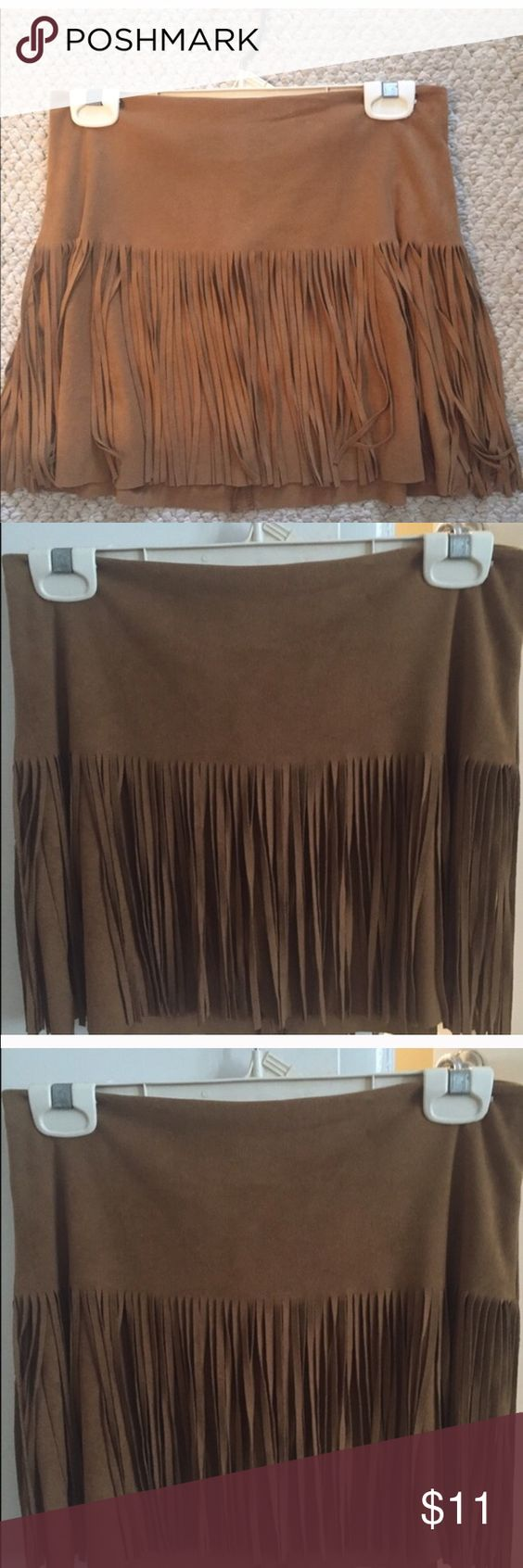 New Woman's Tan Fringe Skirt This is a new never worn tanish brown velvet material fringe skirt very cute. Size 5 Baught from Nordstrom's Department store for 50.00 Skirts