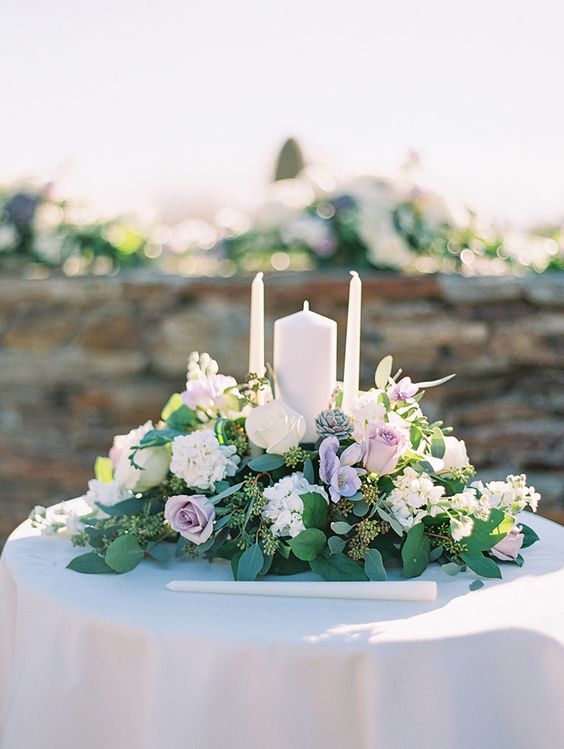 Unity candles and pale purple flowers, outdoor wedding ceremony - Melissa Jill Photography