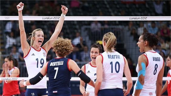 Great Britain players celebrate winning the fourth set in the women's Volleyball preliminary match between Great Britain and Algeria on Day 3 of the London 2012 Olympic Games at Earls Court. July 30, 2012