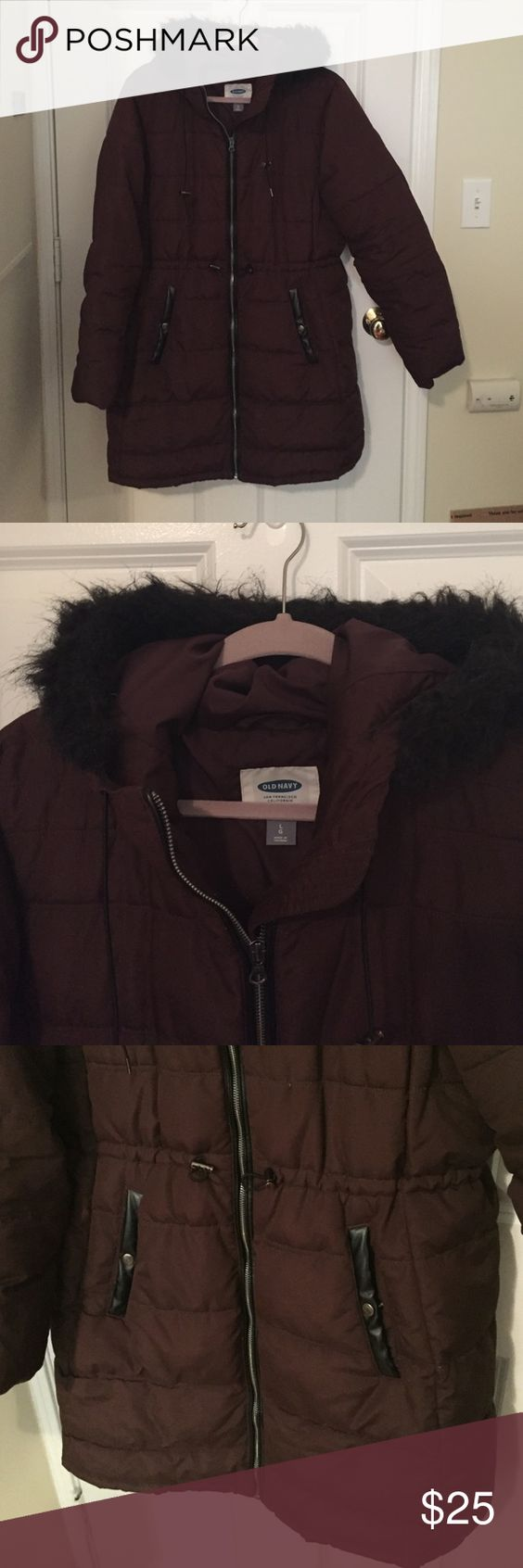 Old navy coat. Old navy coat feather filled. Burgundy color, warm, hits passed butt to about mid thigh. Faux fur hood (not removable faux fur) has two pockets. Design is quilted with a stretchy cinched waist. Worn for a few months last winter. EUC. Old Navy Jackets & Coats Puffers