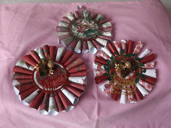 decoration/gift for Christmas  made from paper rolled into cones then glued to circular card