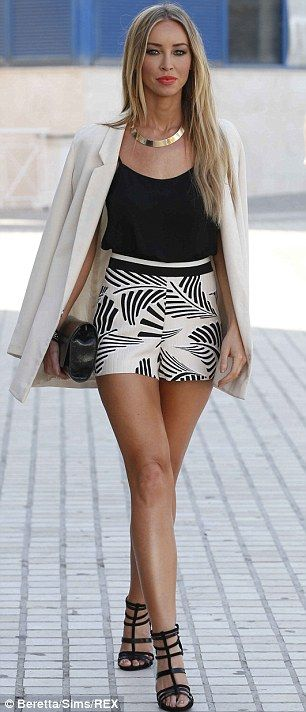 Stylish: While Lauren Pope opted for a chic pair of shorts and matching blazer...