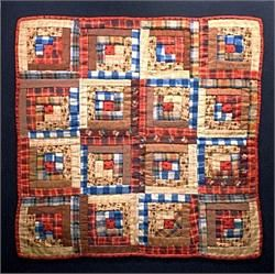 """Fabric, Cotton Batting, Thread…Lancaster County 19th century doll quilt…Sunshine and Shadow log cabin…browns', reds', and blues' comprise this early quilt… Professionaly laundered and mounted…Quilt Size 18 3/4"""" square.. Stretcher Size 21 1/4"""" square."""