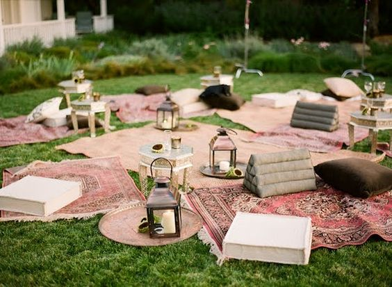 Sunset cocktail party: Looking for a laid back look? Try an elegant version of a picnic with big blankets/rugs and cozy lanterns.