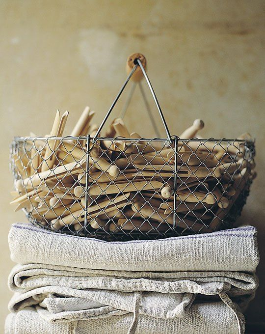 make laundry a pleasure by using traditional wooden dolly pegs kept in wirework basket