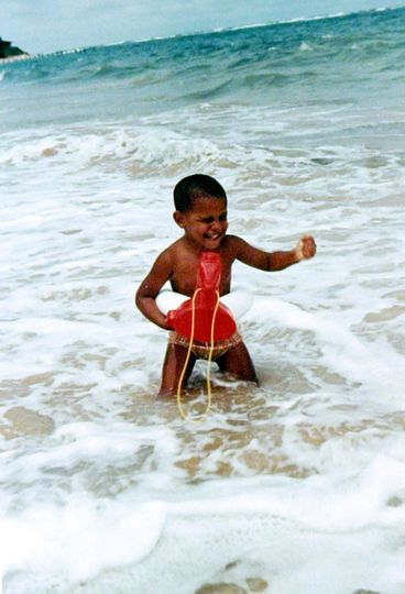 President Barack Obama In Hawaii at the beach. He grew up in the lovely state.