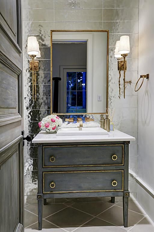 11010 Landon Ln, Hunters Creek Village, TX: Photo G O R G E O U S formal powder room with Ann Sacks glass tile wall accent with perfectly placed sconces and plumbing fixtures. Custom built door and cabinetry complete this elegant space.