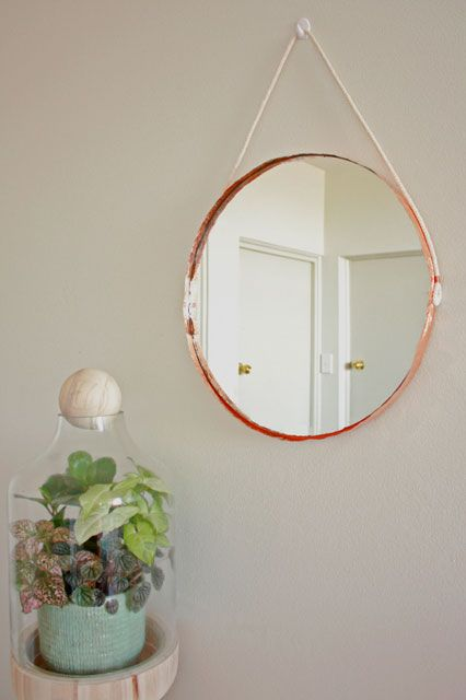 Copper Edge Mirror by Makers Society  The best DIYs fix something you already have. The copper trims on this mirror are a subtle way to introduce that metallic trend into your space.