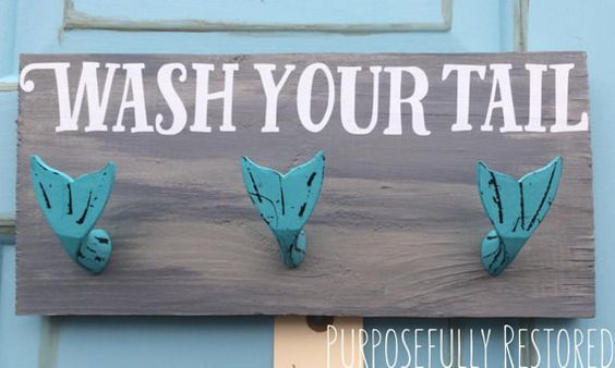 "Towel hooks that will remind your kids to wash their ""tails."""