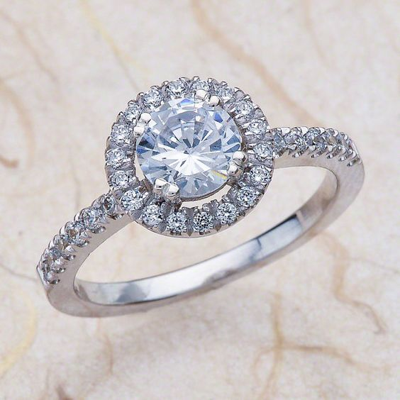 Ladies 14kt white gold diamond engagement ring. The center is a 1.00ctw natural white sapphire. Total diamond weight on the ring is 0.50 carats of