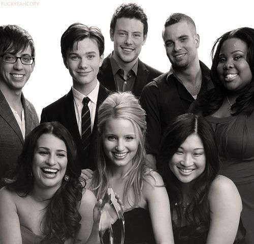 Glee Cast. This show just makes me happy. I thought high school was evil and have a love of musical theater. And I still think every day life should be littered with random outbursts of songs.