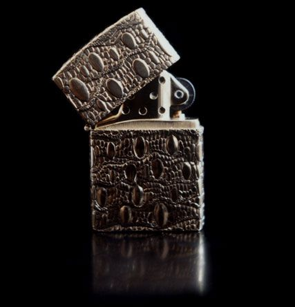 Courts and Hackett, a lizard skin lighter from 1987. Keith Richars commissioned as a gift for Eric Clapton.