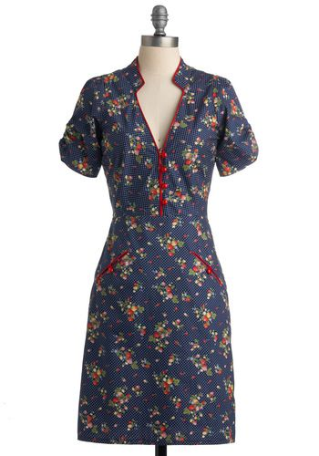 Retro navy Straberry Clafouti dress. Has strawberries/white polka dots all over,  ruched sleeves and cute front pockets