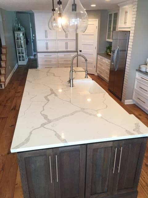 Sparkling White Quartz Countertops Inspirations With Pros And Cons Kitchen Remodel Countertops White Quartz Countertop Kitchen Marble