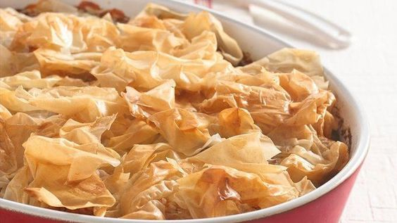 "Crunchy ""flowers"" of prepared phyllo dough top an appealing blend of juicy chicken and vegetables flavored with tomato and garlic."