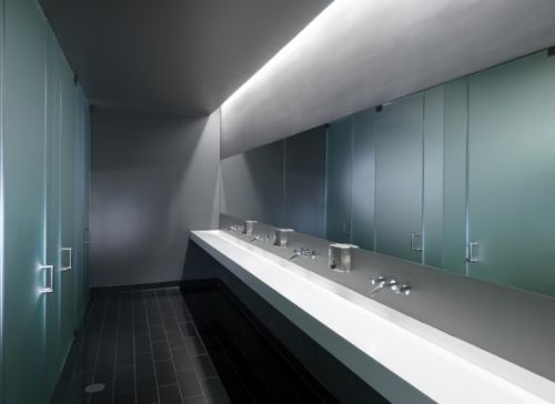 Gallery of conduit stanley saitowitz toilets for Modern public restroom design