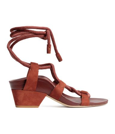 STUDIO COLLECTION/PREMIUM QUALITY. Sandals in suede and leather with crossed straps at front that tie around ankle. Covered heel, leather insoles, and leather and rubber soles. Heel height 2 in.
