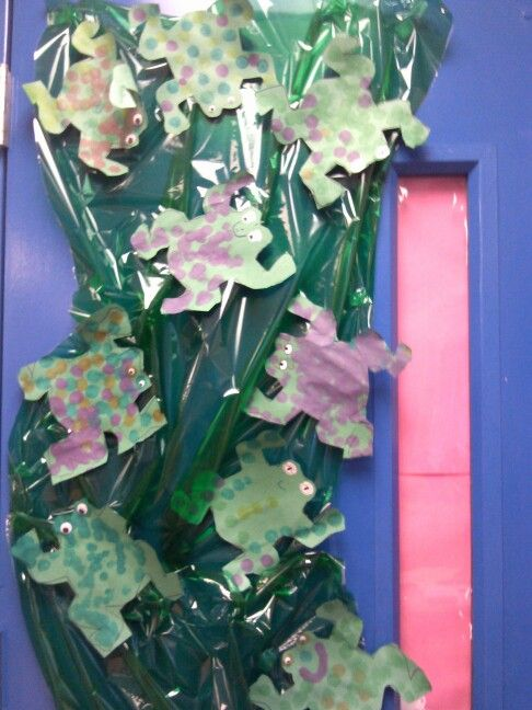 Bullfrogs in the  Jungle waters!!!!   My students first cut out the bullfrog. Then they used dot markers to decorate it. Super fun and easy project for a Jungle Unit! :)