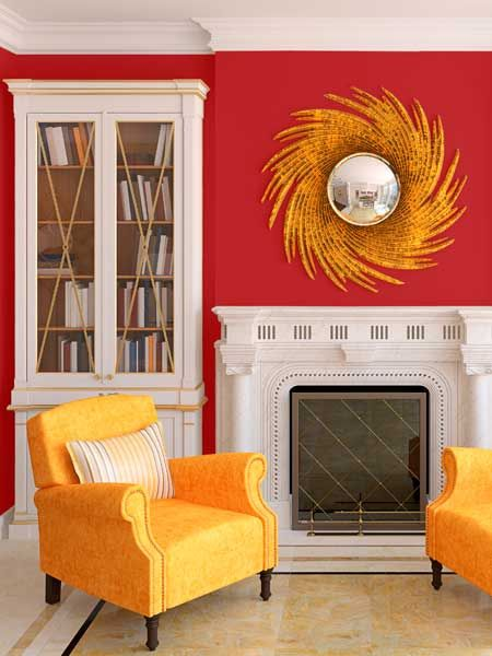 Vivid yellow—that recalls our color for March, Freesia—sets off intense crimson walls and an ornate mantel. | Vibrant Red (4-12), @Pratt & Lambert Paints