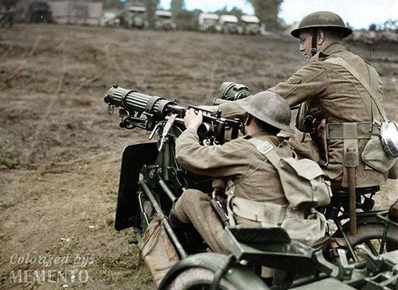 Two British soldiers on a Vickers motorbike operating an attached Vickers MG mounted on the side car, 1918.