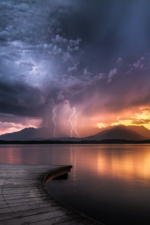 Lightning at Sunset by Alan Montesanto. Storms - Severe Weather - Mother Nature