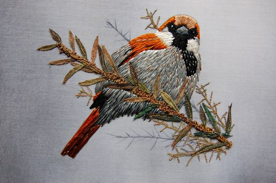 Sparrow by Ruth Norby  Hand embroidered in Natesh with machine embroidered branches and vilene leaves