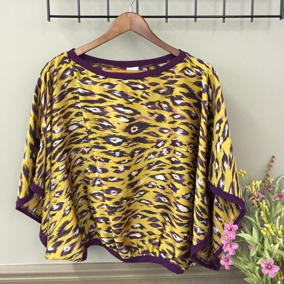 Charming Charlie Animal Print Blouse Yellow and purple animal print batwing top. Silky feel. Crop length. Charming Charlie Tops Blouses