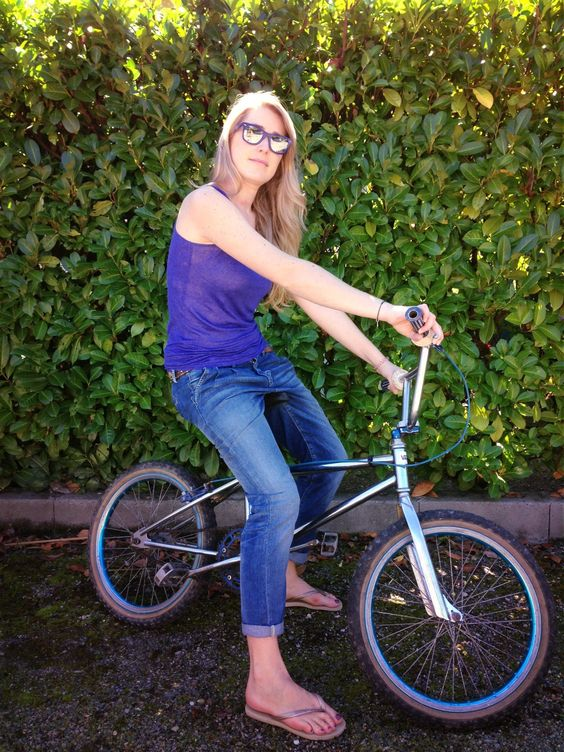 Girl on 80's bike...