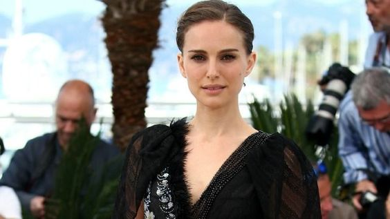 Actress Natalie Portman showed a little more than usual when she appeared at a photo call for her upcoming film on Sunday. Portman looked gorgeous in a stunning black, fringe-lined, sheer gown that actually revealed the 33-yeae-old star's black underwear. Getty Images The sultry star completed the semi-risqué ensemble with sexy, strappy black heels. The photo call was held in France at the Cannes International Film Festival, and was for Portman's upcoming film A Tale of Love and Darkness…