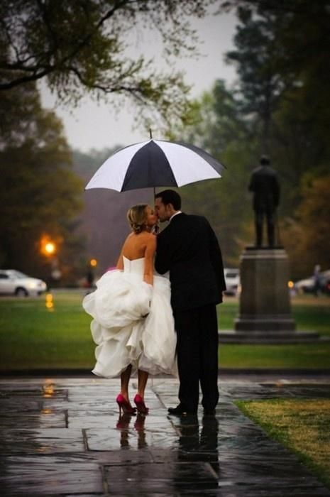 Perfect way to embrace rain on your wedding day.