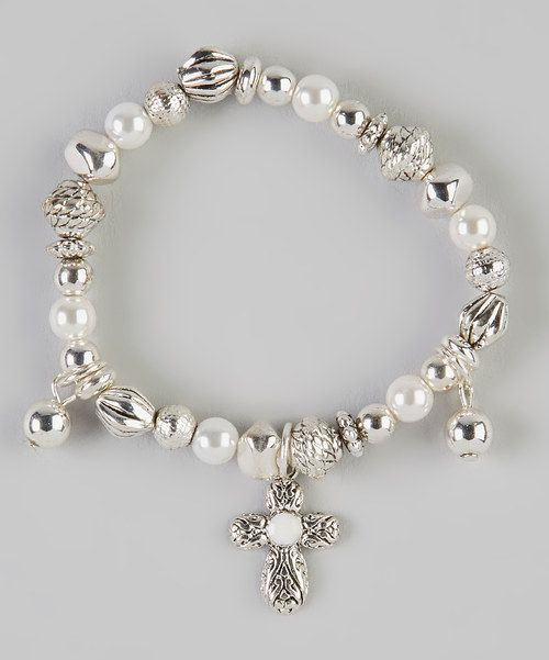 This darling stretch bracelet elegantly decorates the wrist with its delicate beauty. Accented with glistening beads and an inspirational cross charm, it's a timeless treasure that's ready to shine.