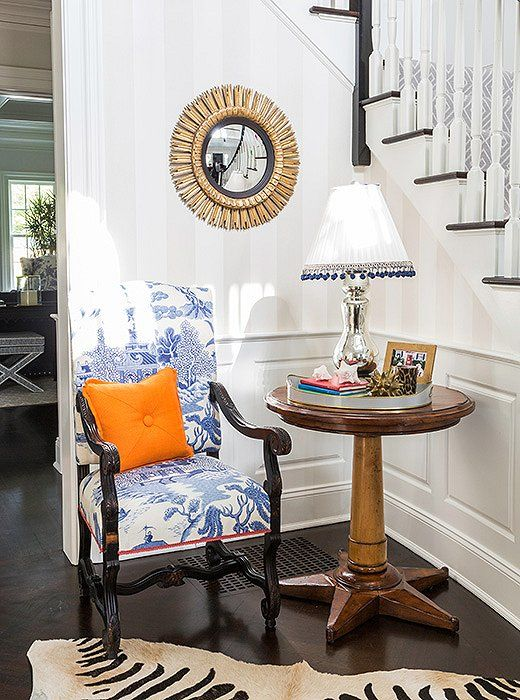 Blue and white armchair for the entryway:
