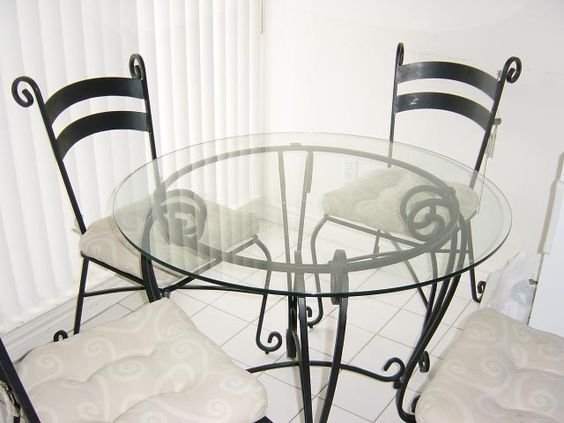 Glass and wrought iron table and chairs pier 1 dining for Pier 1 dining room sets