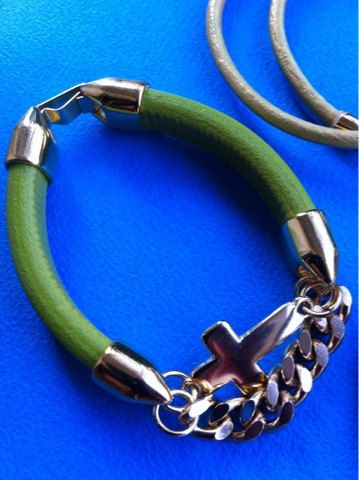 green leather bracelet with gold plated cross and chain