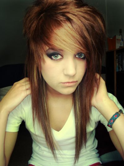 "This is a hairstyle i see ALL THE TIME. personally i love it :) it looks great with highlights and has a lot of spunk. Some people classify this haircut as ""emo"" but that all depends on how you do it up! This is called a scene cut."