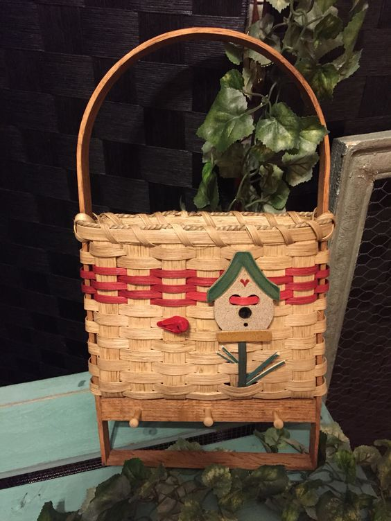 Wall letter basket with pegs and towel. Decorated with ceramic birdhouse and other.