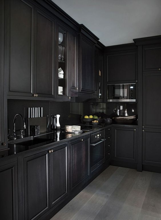 A Chelsea apartment designed as a gentleman's club - desire to inspire - desiretoinspire.net - Hubert Zandberg - all black kitchen
