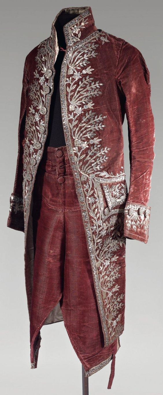Cour coat and breeches, second half 18th century (Louis XVI). Garnet red cut silk velvet lavishely embroidered in a design of flowers and foliage trimmings made of silver and gold sequins and faceted glass.