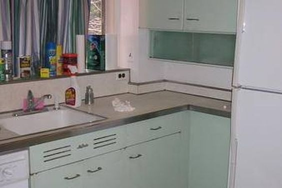 How To Refinish Metal Kitchen Cabinets Hunker Metal Kitchen Cabinets Metal Kitchen Painting Metal Cabinets