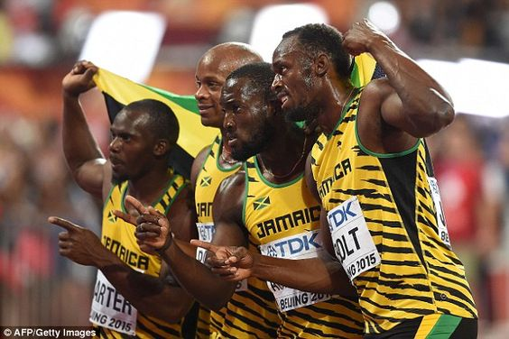 Bolt (right) was all smiles with his team-mates Nesta Carter, Asafa Powell and Nickel Ashmeade afterwards